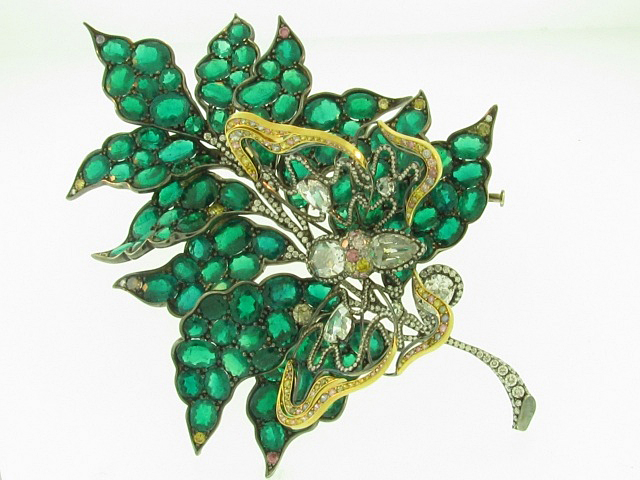 James Currens' brooch with with oval emeralds set in white metals, with colored diamond accents, won Best of Show.