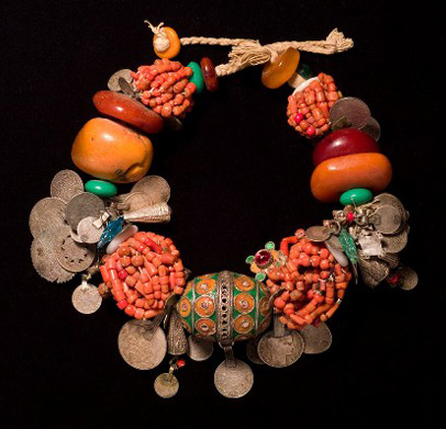 Moroccan necklace of silver, coral, copal, enamel, coins, glass, shell, cotton, plastic and buttons (Desert Jewels exhibit, Philadelphia Museum of Art)