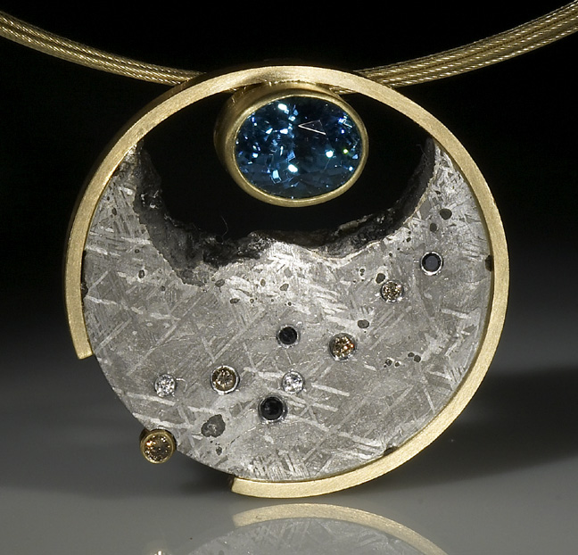 Jacob Albee's Blue Moon Pendant with blue zircon and diamonds set in Gibeon meteoriteteorite.