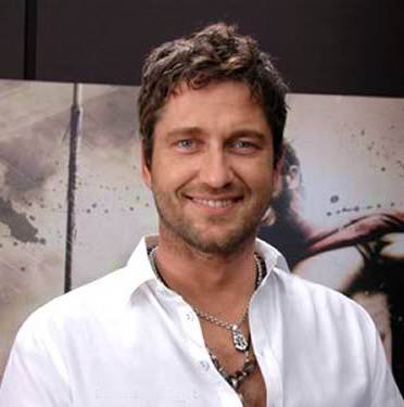 Gerard Butler demonstrates how to layer chunky necklaces under an open collar and still look a man's man. Okay, possibly also a ladies' man.
