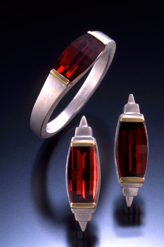 Cast and hand-fabricated ring and earrings of barrel-cut garnet, sterling and 18K gold by Klaus Spies (ring $390, earrings $450)