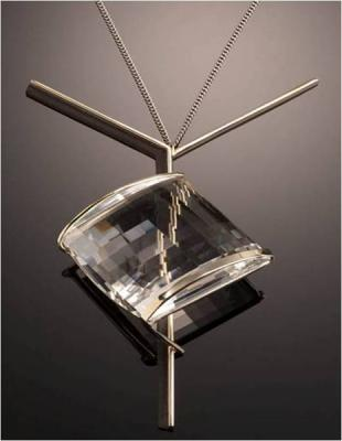 Pendant of faceted quartz, white gold, and ebony by Margaret De Patta, 1959 (Collection of the Oakland Museum of California)