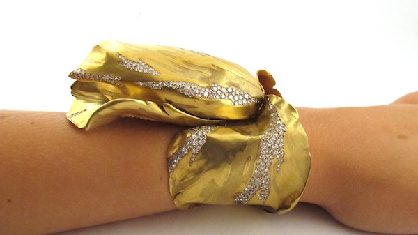 JAR gold tulip bangle worn (Vanessa Cron/Christie's)