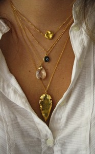 Layered necklaces, including 24k arrowhead from shopkei on Etsy