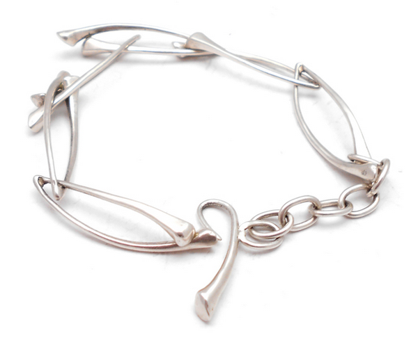 Bracelet of handmade sterling silver links by Niki Grandics of ENJI Studio