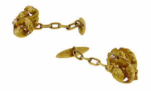 Cufflinks of 18K gold depicting a winged dragon with arrow-shaped tail and diamond in his mouth ($2,025, Aaron Faber Gallery)