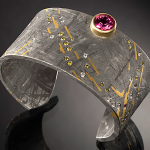 Galileo cuff by Jacob Albee of 2.63ct tourmaline, diamonds, 18k & 24k gold, and Gibeon meteorite