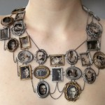 """I Am Who They Were"" neckpiece, 2011, of  decal photographs, sterling silver, bronze, optical glass (collection of the artist)"