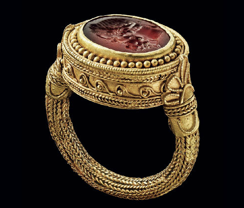 Greek ring, c. 300-330 B.C., of carnelian engraved with head of Herakles set in gold with ropes, filigree, granulation (est. $120-180,000, Christie's NY, Dec. 2013)