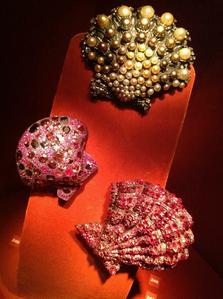 Seashell brooches by JAR (1990, 2009) of spinels, rubies, silver and gold and (2006) Oriental pearls, diamonds, platinum, silver, and gold (private collections/photo Cathleen McCarthy)