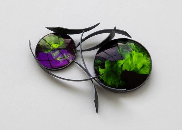 Arboresque Brooch by Jiro Kamata of camera lenses, acrylic paint, blackened silver