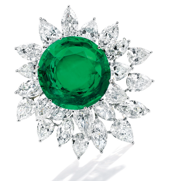 Brooch of platinum, round hollow-back Colombian emerald (21.3 to 20.9 mm by 9.6 mm), pear- and marquise-shaped diamonds (appr. 19.50 carats weight), sold for $346,000 at Sotheby's NY on April 19, 2016.