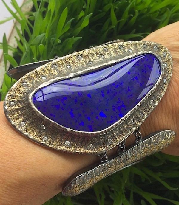 """Wonder Woman"" bracelet by Michael Endlich of 115ct boulder opal, sterling silver, 22k gold dust, and diamonds"