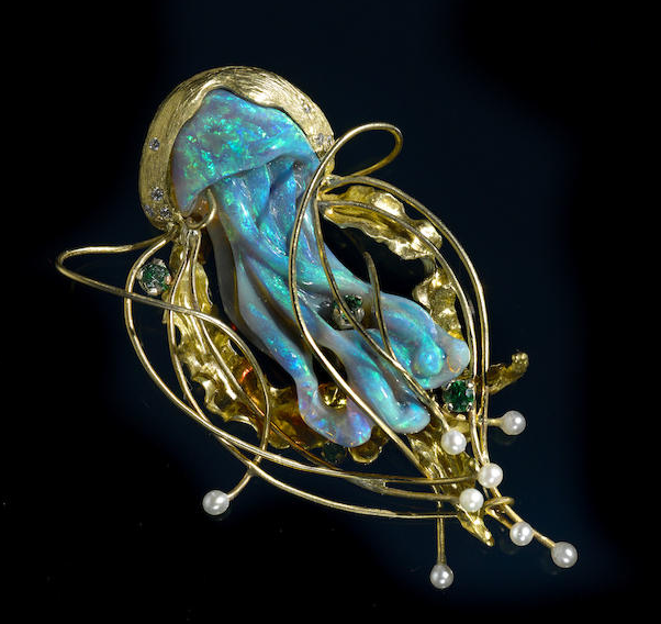 """The Jellyfish (Octopus) brooch of opal carved by Daniela LAbbate, pearls and gold designed by Angela Conty, sold for $5,937 at Bonhams Los Angeles in November 2014"