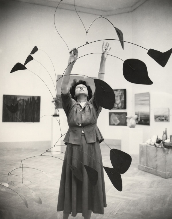 Peggy Guggenheim with mobile