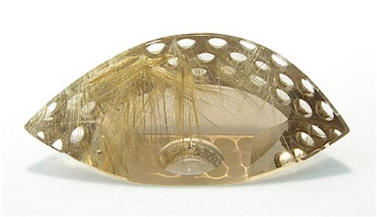 Rutilated quartz palm sculpture by Michael Dyber