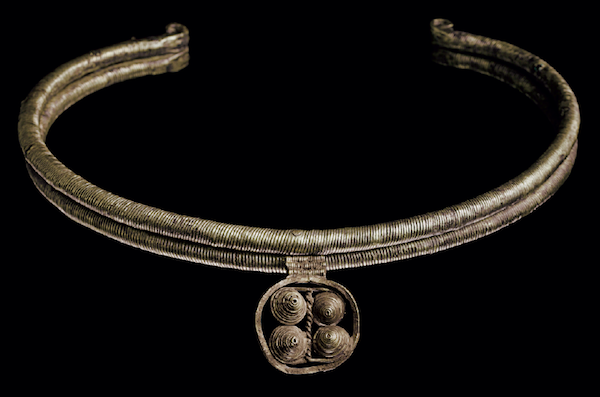 Mesopotamian torque of bronze cores wrapped with electrum sheet, pendant of twisted wire, early Dynastic period, c. 2550-2400 B.C. (est. $3,000-5,000, Christie's NY, Dec. 10, 2013)