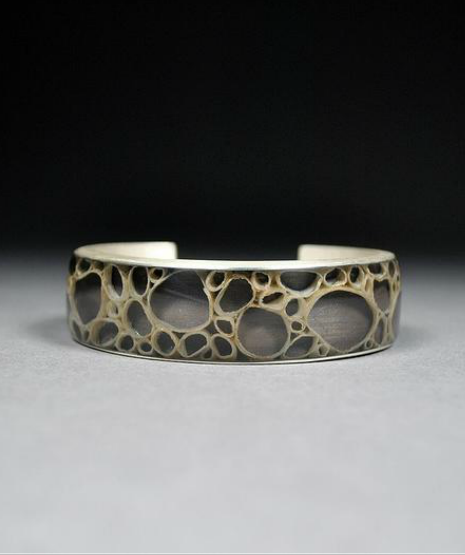 """This is What We're Made of"" cuff bracelet by Elysha Roberts of sterling, Thai Kozo paper, resin, black max"