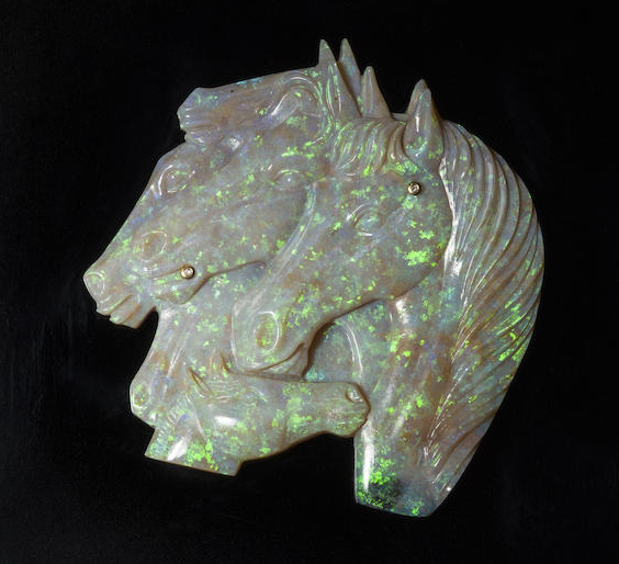 Opal carving of horses
