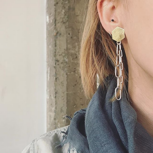 Jera Lodge with earring | How to shoot jewelry on a model: yourself