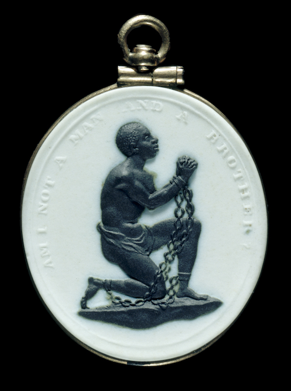 """Slave-in-Chains"" medallion Wedgwood Manufactory (Staffordshire, England) 1786–87 Stoneware (Jasperware), basalt, gold * Bequest of Mrs. Richard Baker * Photograph © Museum of Fine Arts, Boston"