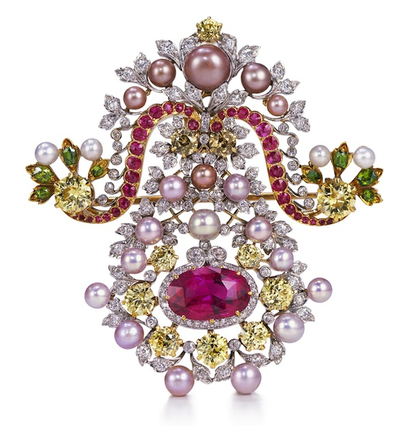 Brooch of platinum, gold, diamonds, pearls, Burmese ruby, demantoid garnets, and pink sapphires, c. 1900, by G. Paulding Farnham for Tiffany & Co.